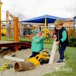 Jenny's ELC Epsom kids playing with sand and trucks