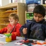 Jenny's ELC Maiden Gully kids painting in smocks